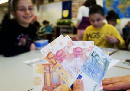 'Kinderen leren te weinig over geld'