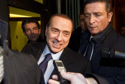 Berlusconi luchtig over seksproces