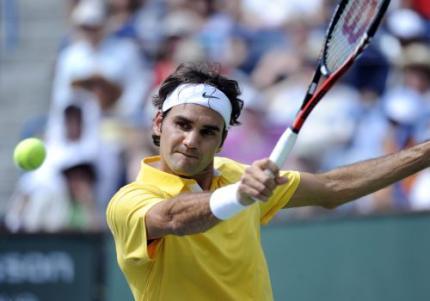 Federer speelt met Rochus