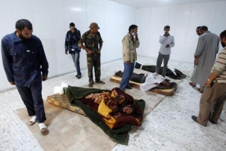Gadhafi wordt in woestijn begraven