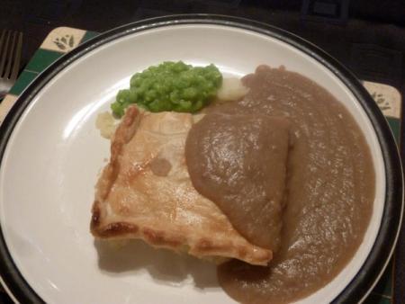 Potato pie with gravy and cream peas