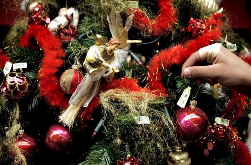 Kunstboom doorn in oog van kerstboomverkopers