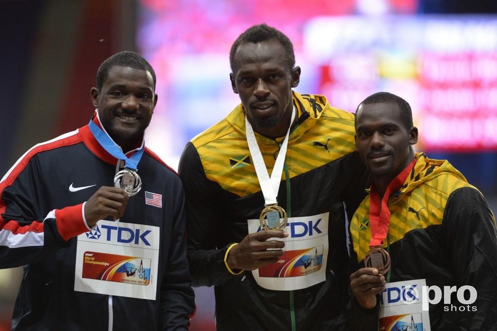 Nesta Carter won in 2013 op het WK brons op de 100 meter, achter Usain Bolt en Justin Gatlin (PROSHOTS/DPPI)