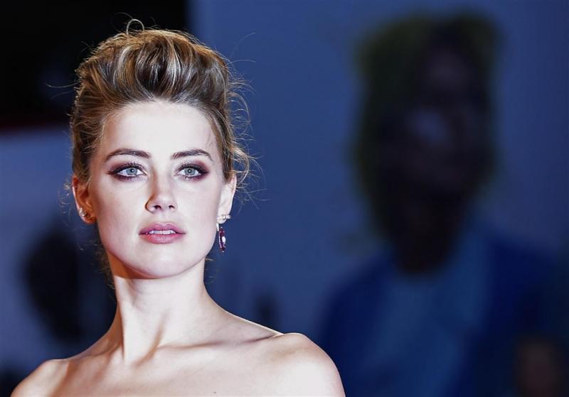 Amber Heard vroeger gearresteerd voor klap