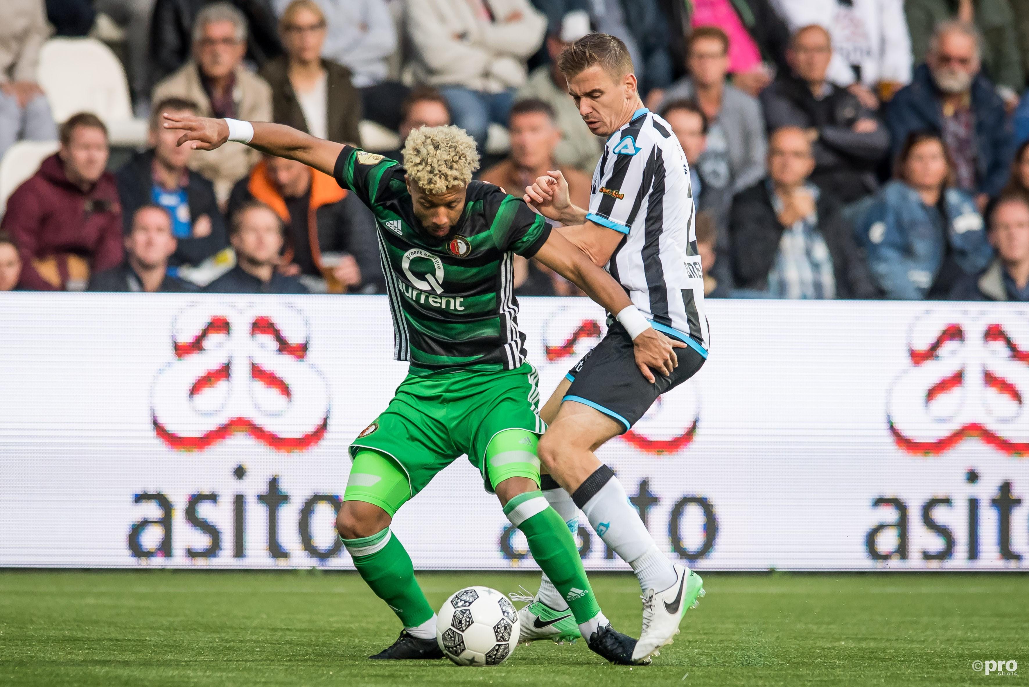 Feyenoorder Tonny Vilhena in duel met Heracles Almelo-speler Tim Breukers.(PRO SHOTS/Lars Smook)
