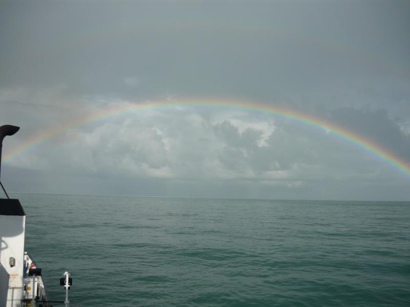 Regenboog op de Noordzee (Foto: Interpretatie)