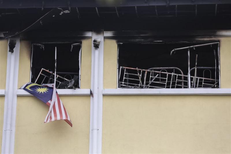 Jongens aangeklaagd na brandstichting school