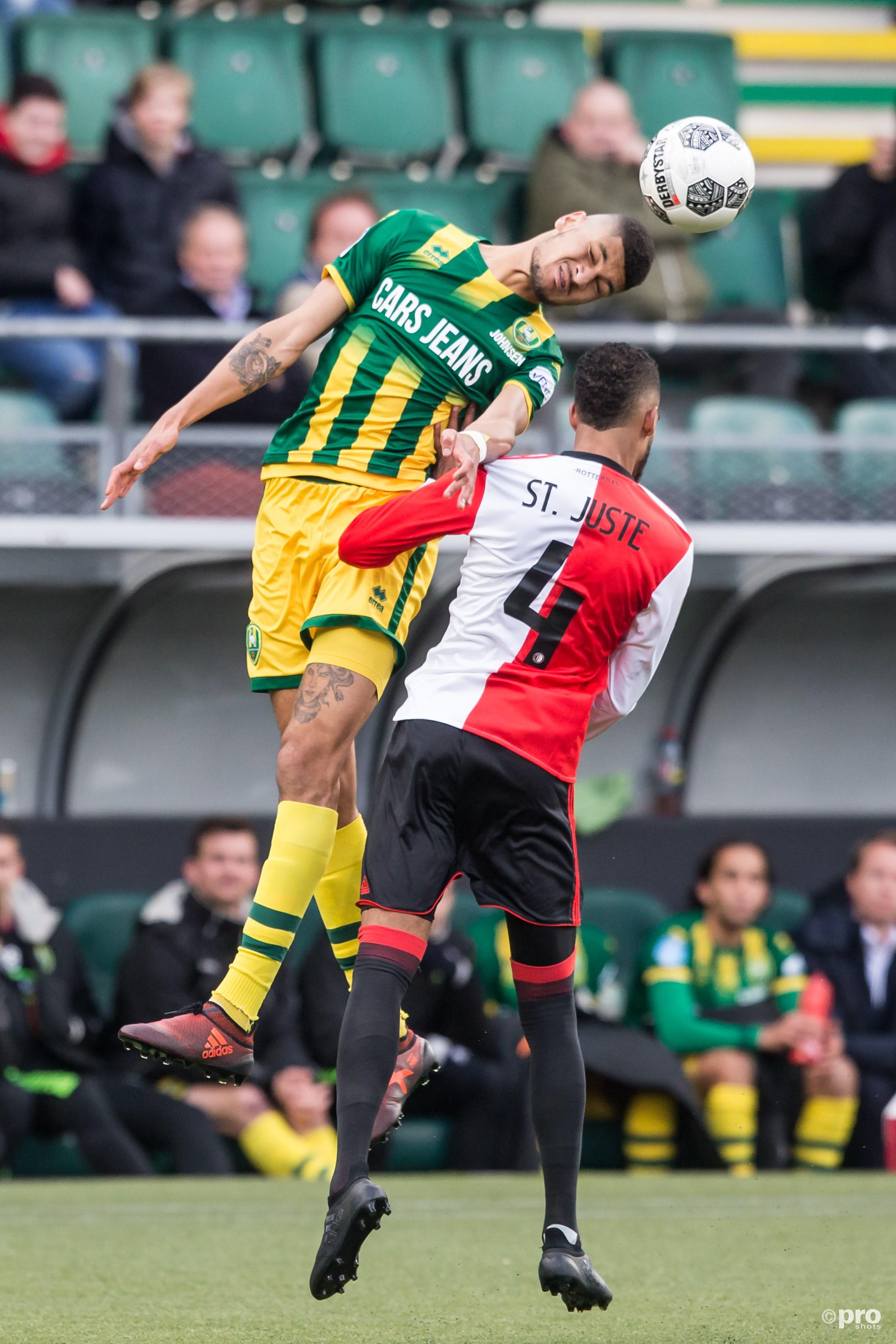 ADO Den Haag speler Bjorn Johnsen (L) in duel met Feyenoord speler Jeremiah st. Juste. (PRO SHOTS/Marcel Bonte)
