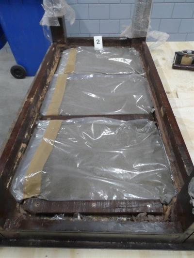 58 kg heroïne in container met huisraad (Foto: Openbaar Ministerie)