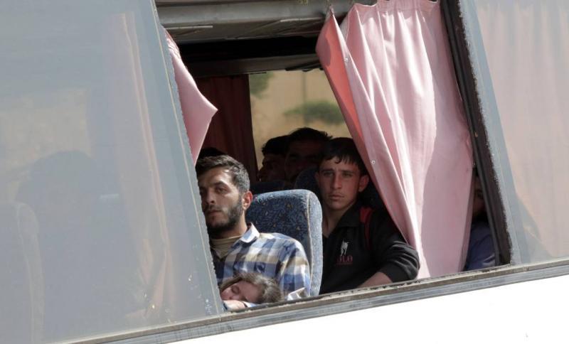 Rebellen vertrekken per bus uit Douma