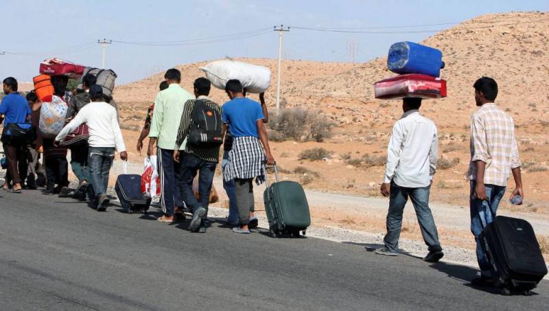 Mensensmokkelaars schieten op vluchtelingen