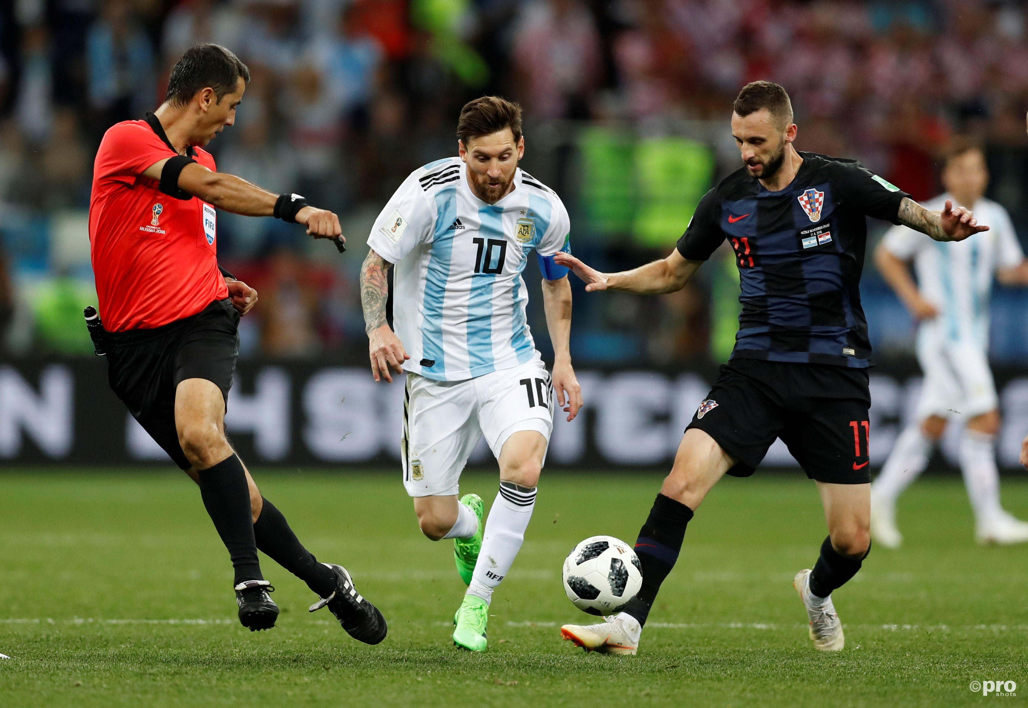Lionel Messi in action with Croatia's Marcelo Brozovic. (PRO SHOTS/Action Images)