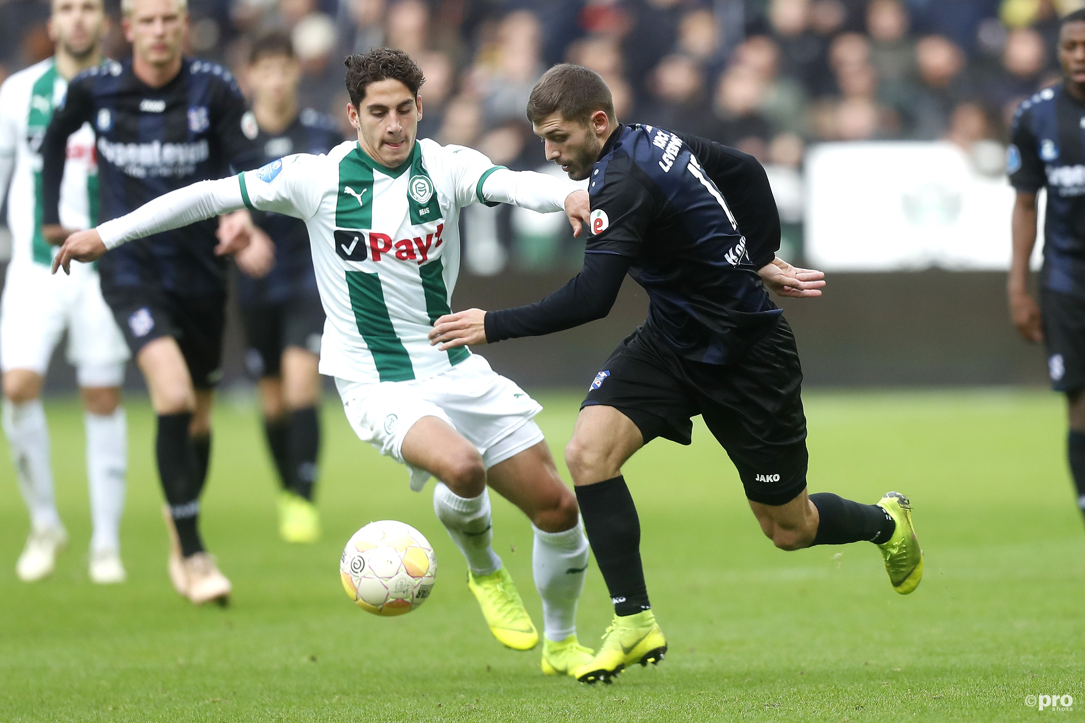 Ludovit Reis (FC Groningen) in duel met Arber Zeneli (sc Heerenveen). (PRO SHOTS/Henk Jan Dijks)