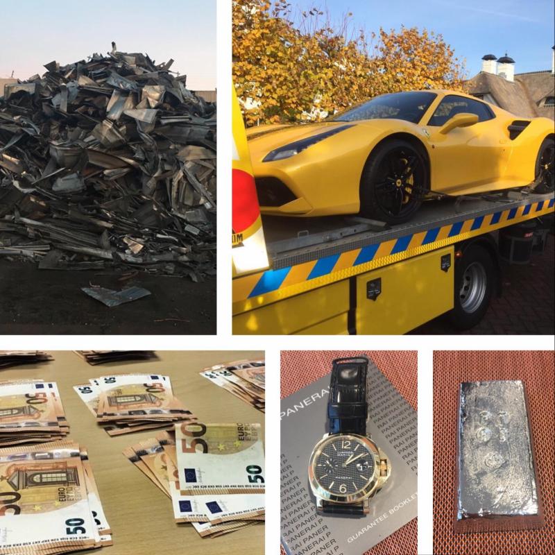 Luxe auto's, geld en schilderijen in beslag genomen wegens miljoenenfraude (Foto: FIOD)