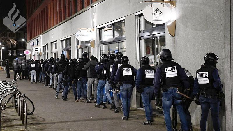 Miljoenen euro's en auto's in beslag genomen bij acties Den Haag (Foto: Politie)