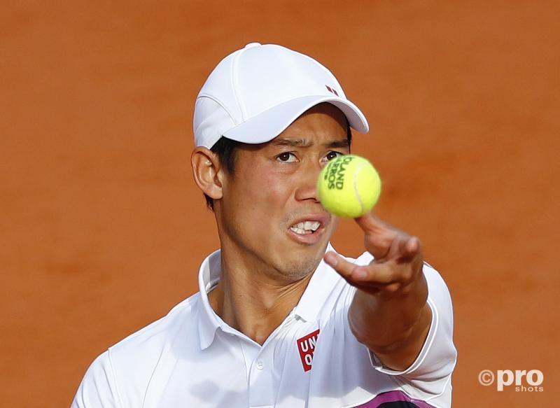 De Japanner Kei Nishikori lijkt iets van plan met de bal, wat is hier gaande? (Pro Shots / Action Images)